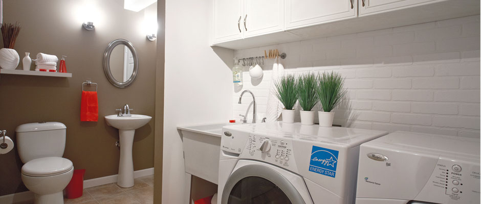 Wash Room with washer-dryer combo, toilet and vanity