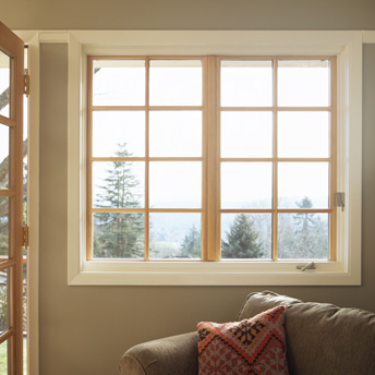 Properly measure the interior window frame to install curtains in the library