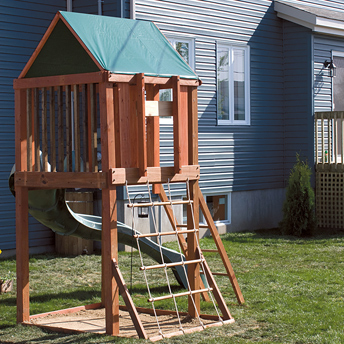An elevated play fort has a slide, rope ladder, and a solid ladder.