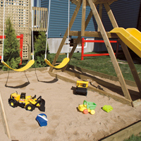 Play structure including a sand box