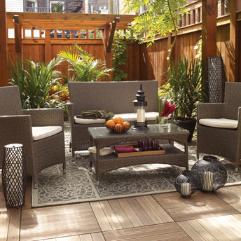 Deck tiles, furniture, palm trees, and decorative items complete the outdoor space.