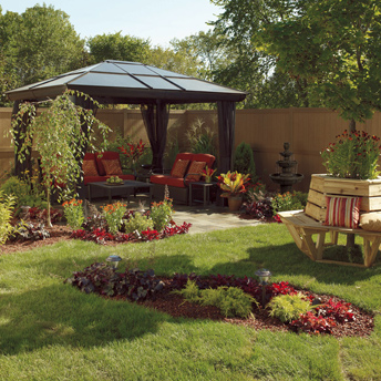 Gazebo, tree bench, fresh plantings, a fence, and outdoor furniture.