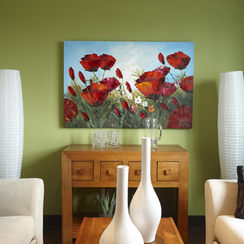 Artwork pops against a celery green wall