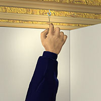 Hang the grid's wiring from an eyelet installed onto the joist.