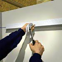 Install the L-shape moulding around the room's perimeter.