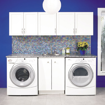 Vibrant laundry room with work space and cabinets