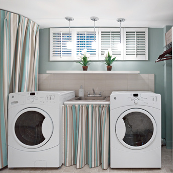Laundry room with storage and laundry tub
