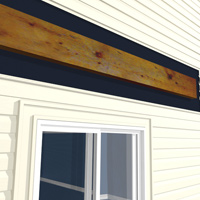 Siding is removed to attach ledger board.