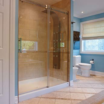 A preformed  shower base can be used with ceramic tile shower walls