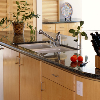Undermount white kitchen sink in a granite or stone countertop