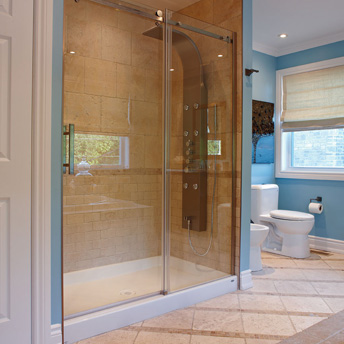 Tiled shower with preformed base and glass doors
