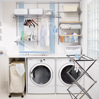 Vibrant laundry room with storage and work space