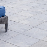 Square paving slabs lend a sleek, contemporary look.