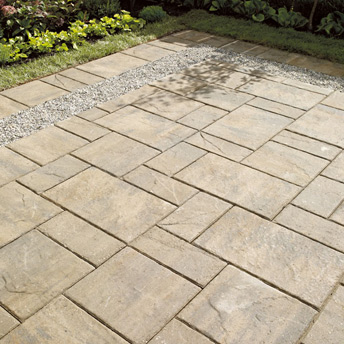 Pebble border set into a patio of pavers