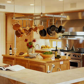 A pot rack above the island is both stylish and practical