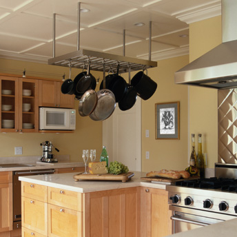A pot rack above the work area and close to the cooking area