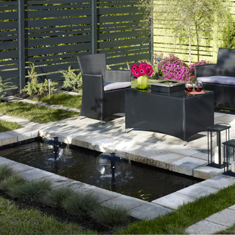 Square edges and manicured landscapes make this water garden feel formal and modern