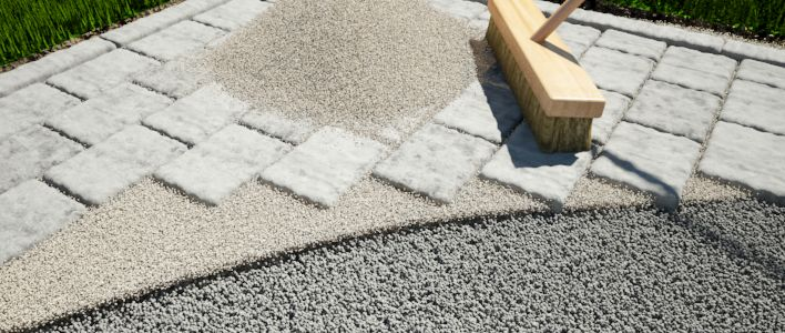 Brush polymeric sand over the pavers or slabs
