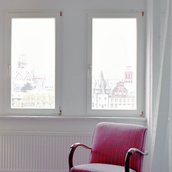 Properly measure the interior window frame to install curtains in the living room