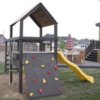 Play structure including a climbing wall