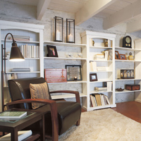 Reading room or library including a few bookshelves coupled with comfortable leather recliners