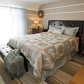 A beautiful leather bedhead is a perfect addition to a master bedroom.