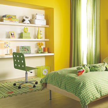 An unusual colour combination—canary yellow and mint green—livens a young girl's room