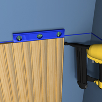 Apply a wavy line of adhesive along the back and drive the nails through the tongue of the wainscot board.