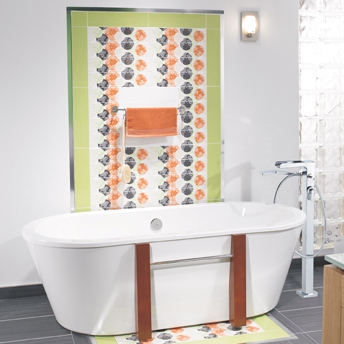 Decorative layout composed of ceramic tiles on the wall behind the bathtub.