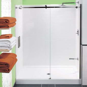 Moulded acrylic panels and glass shower doors can be installed on a preformed shower base.