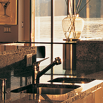 Undermount stainless kitchen sink in a granite or stone countertop