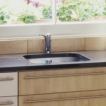Single-bowl kitchen sink under solid-surface countertop