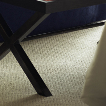 Wall-to-wall textured carpet in the living room