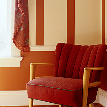 Chair and picture rails can dress up a wall.