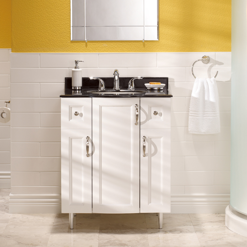 A traditional white vanity adds storage space