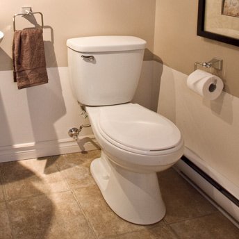 Two-piece toilet in a bathroom