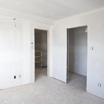 Drywall is hung on wall and ceiling studs.